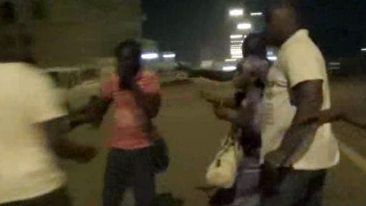 In this image taken from video from AP Television, plain-clothed policemen leading people away near the Splendid Hotel, Friday, Jan. 15, 2016, in Ouagadougou, Burkina Faso. The SITE Intelligence Group reports that an al-Qaida affiliate is claiming responsibility for the ongoing siege on an upscale hotel and cafe in Burkina Faso's capital where an unknown number of hostages are being held.