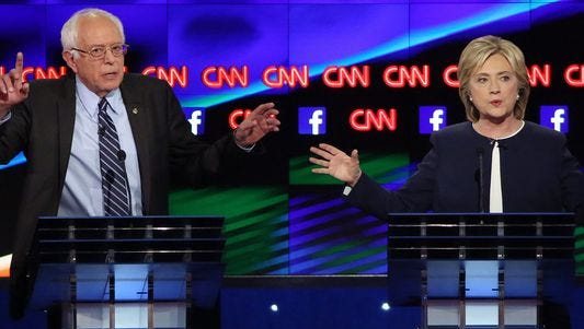 Bernie Sanders and Hillary Clinton attend a CNN debate.