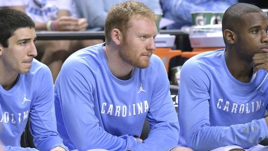 Christ School alum Spenser Dalton, center, is a senior for the North Carolina basketball team.