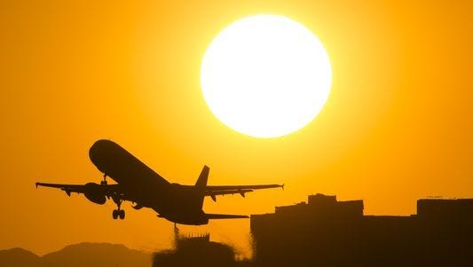 A jet takes off from Sky Harbor International Airport in Phoenix. Record heat is forecast to scorch the Southwest this week.