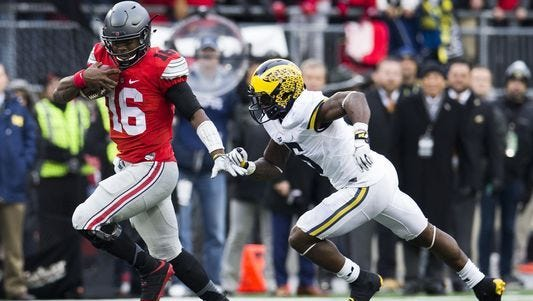 J.T. Barrett, here trying to stiff-arm Michigan's Jabrill Peppers, will try Saturday to become Ohio State's first starting quarterback to go 4-0 against the Wolverines.