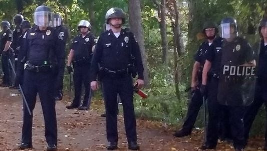 Local police, firefighters and ambulances in New Hampshire responded to large crowds of students rioting at the annual Pumpkin Festival at Keene State College.