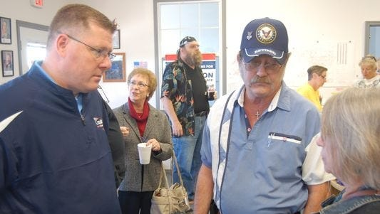 U.S. Rep. Rick Crawford speaks to David and Geraldine Butts, of Mountain Home, during a visit to Baxter County last week.