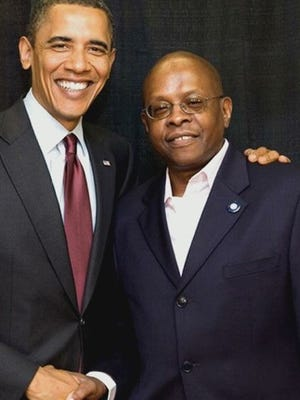 Ken Preston, Rochester, poses for a photo with President Barack Obama.