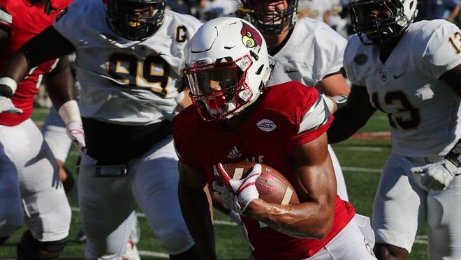Louisville's Reggie Bonnafon runs for a touchdown against Murray State.