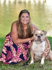 Ashley Mooneyham with her dog, Willy, finds beauty