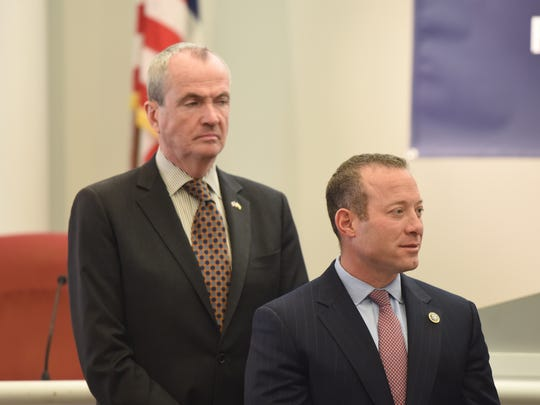 Gov.-elect Phil Murphy stands behind Rep. Josh Gottheimer, D-Wyckoff, at a on Jan. 5, 2018 news conference on the new cap on deducting state and local taxes from federal returns.