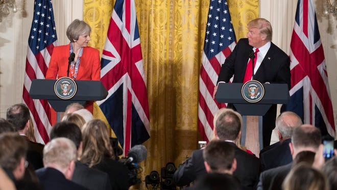 President Trump and British Prime Minister Theresa May take part in a joint press conference in the East Room of the White House on Jan. 27, 2017.