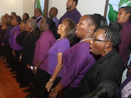 The Friendship Baptist Church Choir performs during the Dr. Martin Luther King Jr. Commemorative Ecumenical Service Sunday at New Image Tabernacle in North Fort Myers.