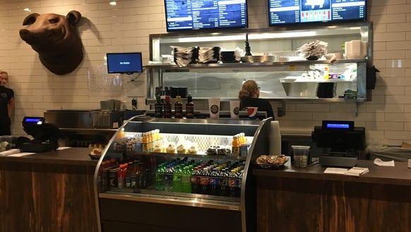 Customers order at the counter at Cody's Smokehouse