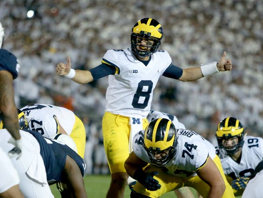 Michigan quarterback John O'Korn has passed for just one touchdown this season in six games.