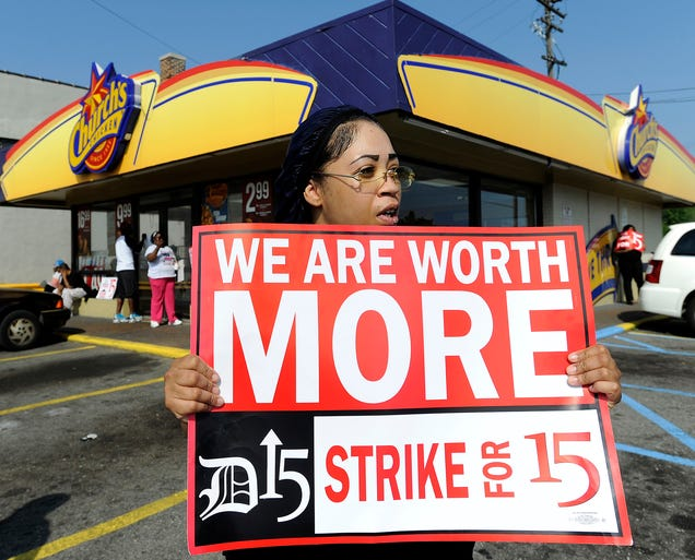 Taco Bell employee Shanise Stitt pickets with other protesters in front of a Church's Chicken fast food restaurant Aug. 29 in Detroit. Fast food employees and supporters staged demonstrations in several cities during a nationwide protest for higher wages.