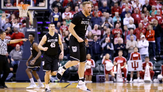 Butler's Tyler Lewis celebrates during the team's defeat of Indiana.
