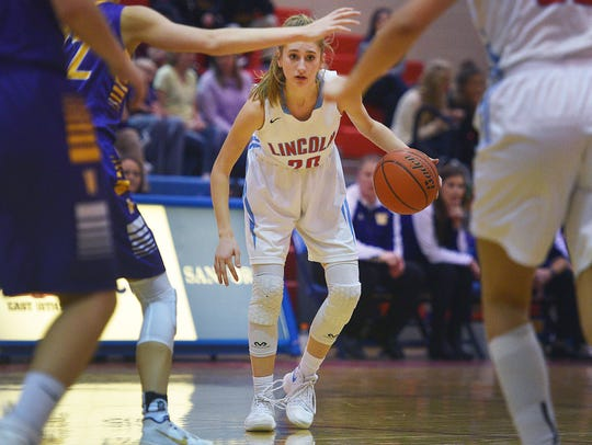Lincoln's Courtney Klatt goes against Watertown defense