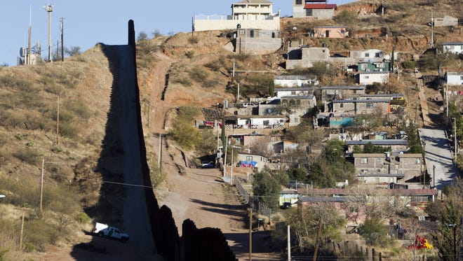 A federal judge has postponed until June 2017 the trial of a Border Patrol agent who killed a Mexican teen in Nogales. Shown is the border fence between Nogales, Arizona, and Nogales, Sonora.