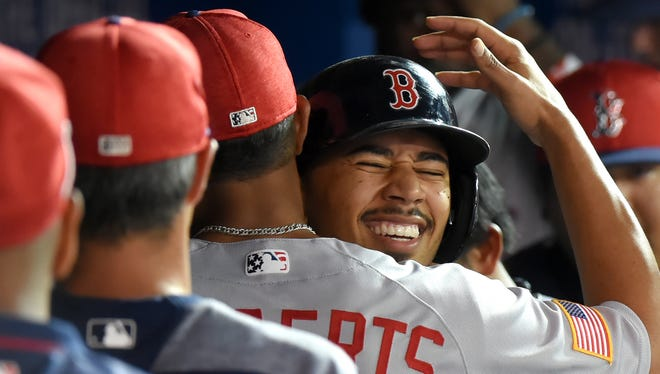 Mookie Betts homered twice and drove in eight runs against Toronto on Sunday.