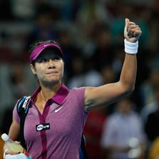 BEIJING, CHINA - OCTOBER 01:  Na Li of China celebrates after defeating Francesca Bojana Jovanovski of Serbia on day four of the 2013 China Open at the National Tennis Center on September 29, 2013 in Beijing, China.  (Photo by Lintao Zhang/Getty Images)