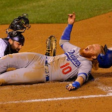 DENVER, CO - SEPTEMBER 16:  Justin Turner #10 of the Los Angeles Dodgers screams as he's tagged out by catcher Michael McKenry #8 of the Colorado Rockies during the sixth inning at Coors Field on September 16, 2014 in Denver, Colorado. (Photo by Justin Edmonds/Getty Images)