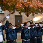 American Legion Post 492 Firing Squard with a volley before the sounding of Taps at the Veterans Day Program Monday, Nov. 11, 2013, at MacArthur Auditorium at the Indiana Veterans' Home in West Lafayette.