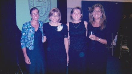 From left, Theresa Tuthill, Nancy Melvin- Taylor, Christine Joor Mitchell and Doreen Gostin Massie gather to celebrate Melvin-Taylor's induction into the University of Rochester Athletics Hall of Fame in 2003.