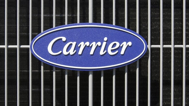 This April 21, 2009, file photo shows the Carrier logo on an air conditioning unit in Omaha, Neb.