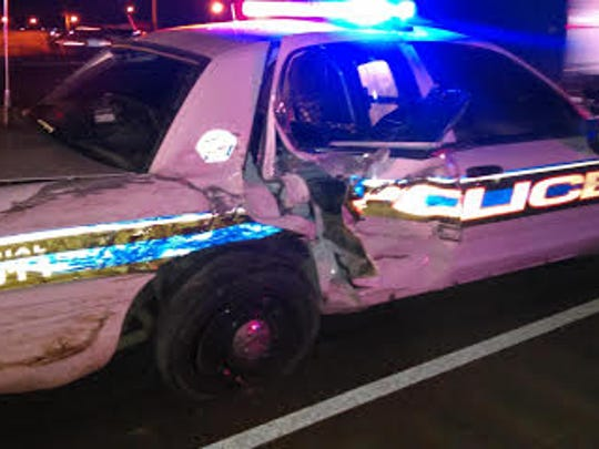 Damage to an Anthony, Texas, Police Department patrol unit is shown Saturday morning after it was struck by another vehicle, sending it into a police officer assisting at the scene of a crash.