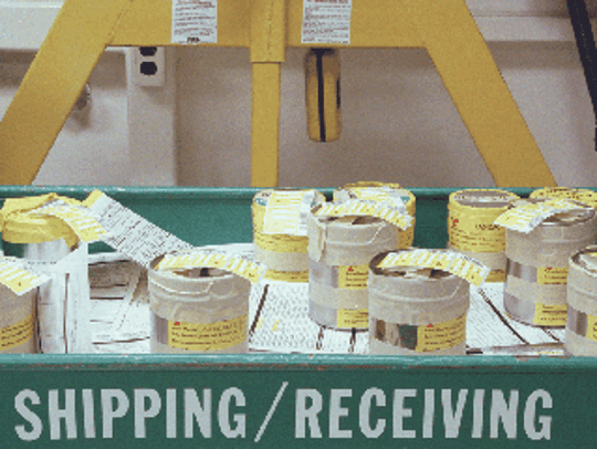Packages containing plutonium await shipment from a