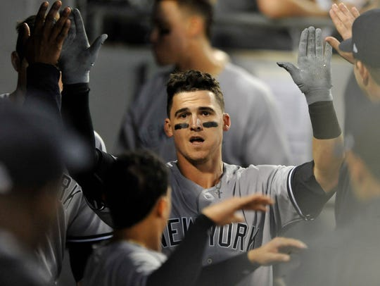 New York Yankees' Tyler Austin, here celebrating with