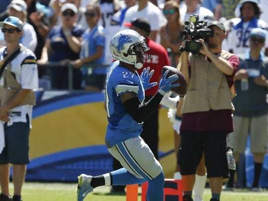 Lions free safety Glover Quin scores a touchdown off an interception against the Chargers during the first half on Sept. 13 in San Diego.