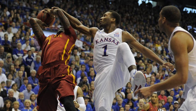 Iowa State forward Jameel McKay (1) is fouled by Kansas guard Wayne Selden Jr. (1) in the first half at Allen Fieldhouse.
