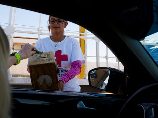 A volunteers for the Cruz Roja Mexicana (Red Cross) collect donations in town.