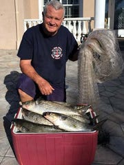 Iona fisherman Terry Gibson needed only one throw of his cast net to catch 22 fat fall mullet Monday in Punta Blanca Bay. He needed pal John McDaniel's help to pull the net into the boat.