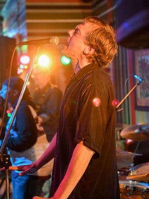 Southeast Polk teacher Jeff Hart performs with his band, Vinyl Vagabonds, on Saturday, Jan. 7, at Mother's Pub in Ames.