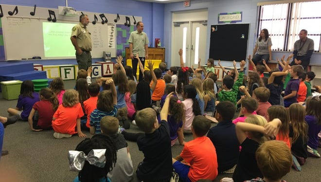 Garden Club of Stuart members and Florida Forestry Department's Senior Forester Calin Ionita talk to Bessey Creek Elementary School students about Arbor Day.