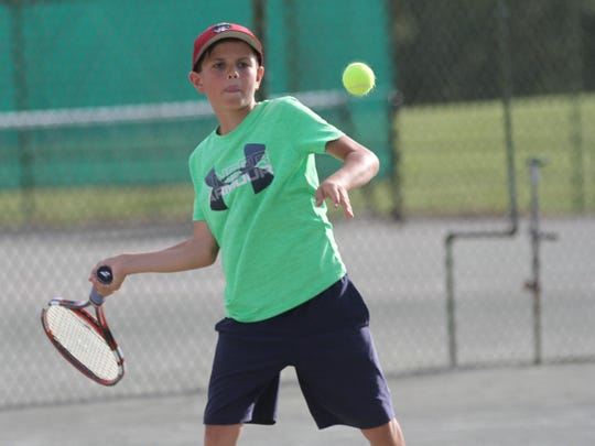 Harrison Arnholt zeros in on a forehand in his boys 10 singles final against Owan Gongwer in the 84th News Journal Tennis Tournament at Lakewood Racquet Club.