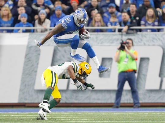 Detroit Lions tight end Eric Ebron (85) jumps over Green Bay Packers free safety Jermaine Whitehead (35) after a catch during the second quarter at Ford Field.