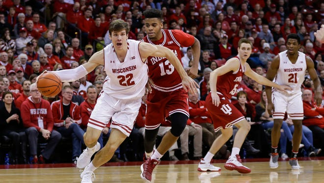 Wisconsin's Ethan Happ (22) drives past Indiana's Juwan Morgan (13) during the second half of an NCAA college basketball game Tuesday, Jan. 2, 2018, in Madison, Wis. Happ had a game-high 28 points in Wisconsin's 71-61 win.