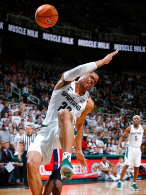 Michigan State's Miles Bridges goes down with an injury as he drives against Stony Brook during the second half of an NCAA college basketball game, Sunday, Nov. 19, 2017, in East Lansing, Mich.