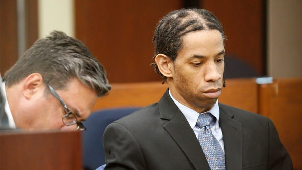 Carlos Antonio Holcombe, 45, is shown during his trial
