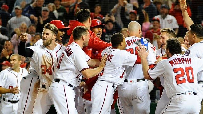 Bryce Harper reacts towards home plate umpire Brian Knight.