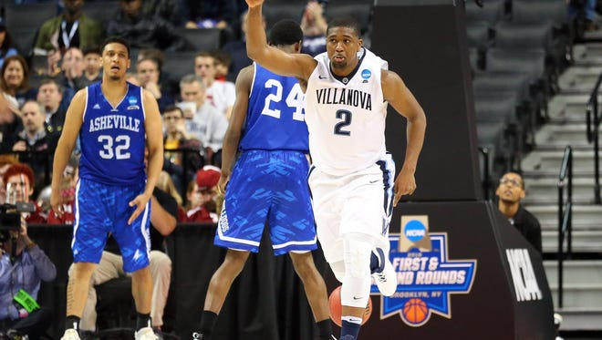 Mar 18, 2016; Brooklyn, NY, USA; Villanova Wildcats forward Kris Jenkins (2) reacts after a basket against the North Carolina-Asheville Bulldogs in the second half in the first round of the 2016 NCAA Tournament at Barclays Center.