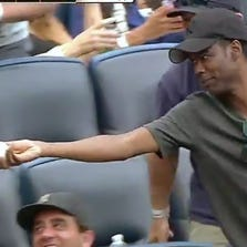 Comedian Chris Rock gets a foul ball in the stands while sitting with Bobby Cannavale at Yankee Stadium, then flips it to a fan