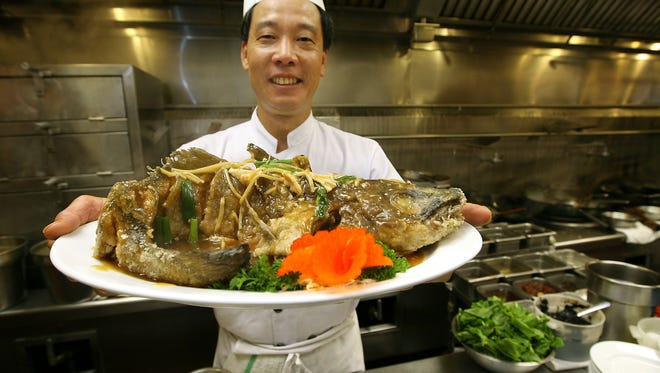 Chef Yong Hu shows Braised Whole Cod Fish with Meat at New Asia
