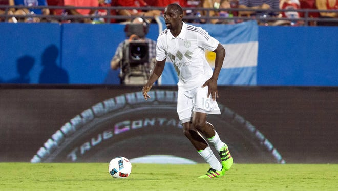 Sporting Kansas City midfielder Lawrence Olum (16) dribbles the ball against FC Dallas in the second half at Toyota Stadium.