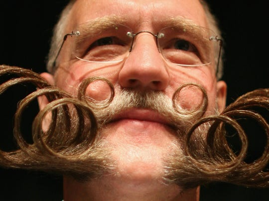 A competitor poses while competing during the World Beard and Moustache Championships at the Brighton Centre on September 1, 2007 in Brighton, England.