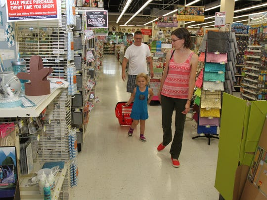 Michael Secord, of Neptune, with his daughter Claire, 4, and wife Janet, shop at the A.C. Moore store in the Seaview Square Shopping Center in Ocean Township.