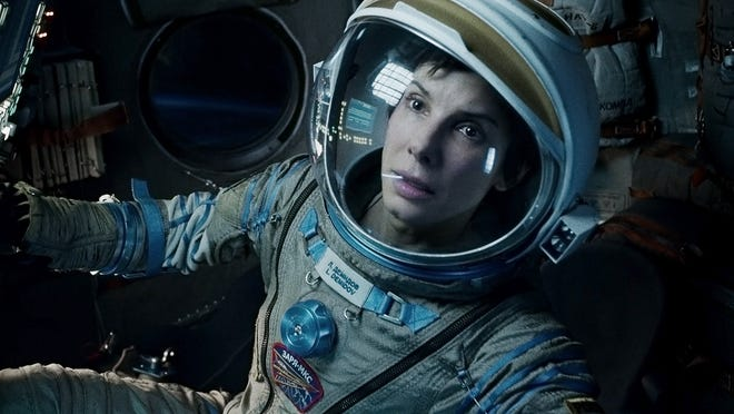 'Gravity,' starring Sandra Bullock, wins the Golden Tomato award for best reviewed film of the year from Rottentomatoes.com