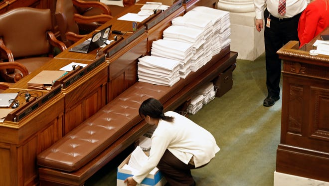 Paperwork piles up during the legislative session Wednesday, May 10, in St. Paul. The GOP began moving on its bills in the midst of what had been high-level negotiations with the governor over working out differences before adjournment late next week.
