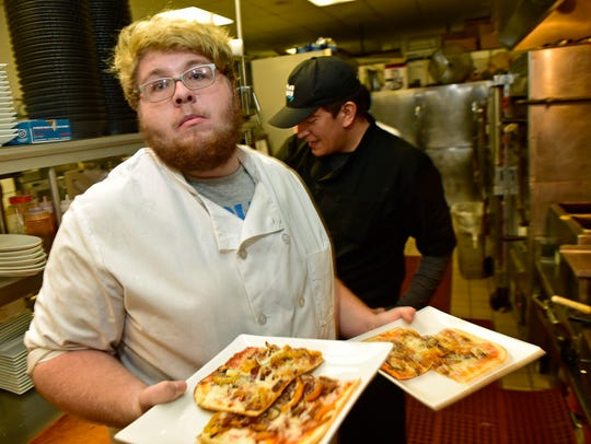 Hunter Conner works in The Orchard's kitchen on Tuesday,