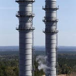 This Nov. 16, 2015 photo shows two stacks of the heat recovery steam generator area of the Mississippi Power Co. carbon capture power plant in DeKalb, Miss. After repeated delays, the project now has a completion date of June 30, 2016 - two years behind schedule, and there are doubts even that deadline will be met. (AP Photo/Rogelio V. Solis)